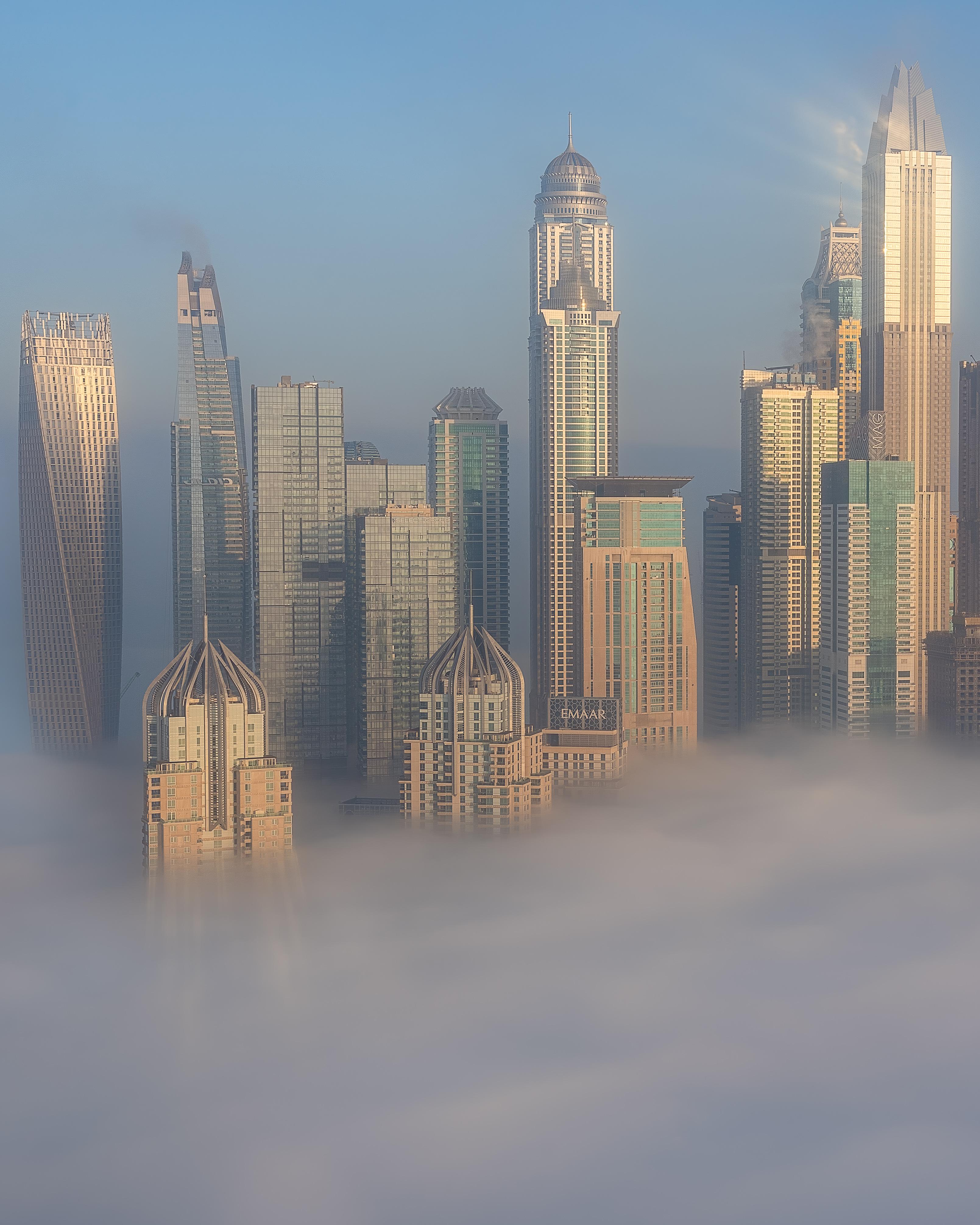 The Dubai Marina skyline rising up out of the fog.