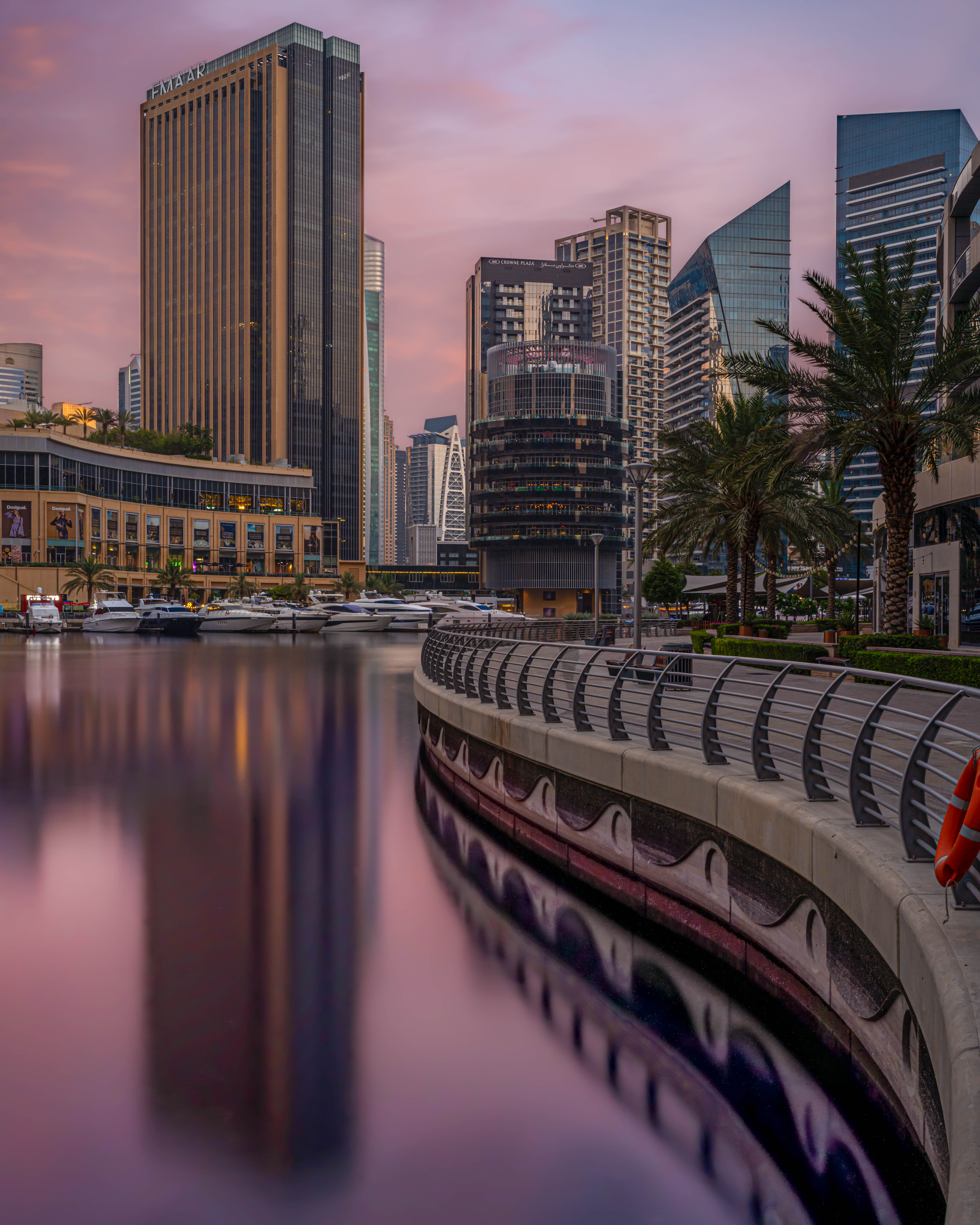4. Dubai Marina Mall and Pier 7 from the promenade on the other side of the water.