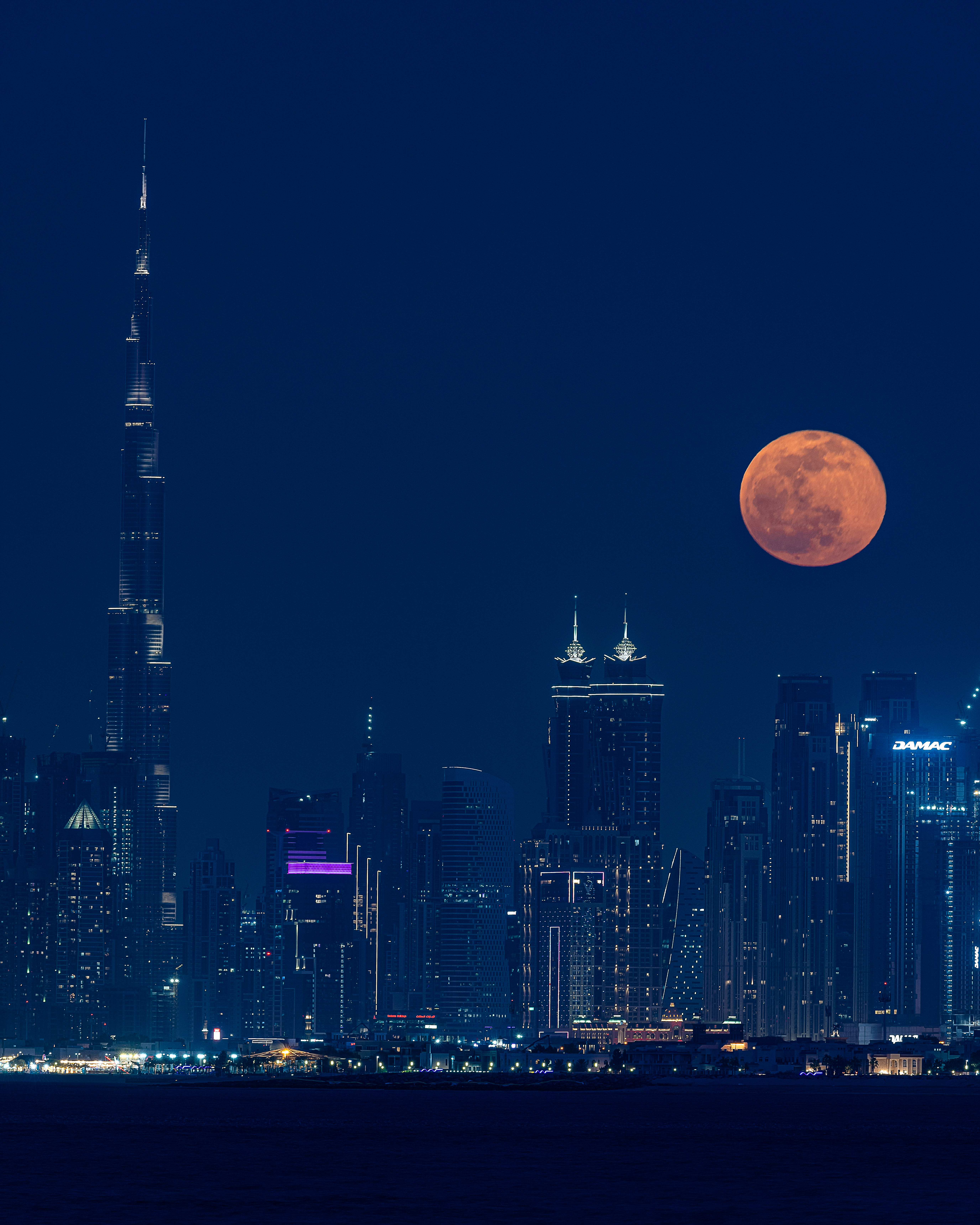 Moon rise over the Downtown skyline from The Palm