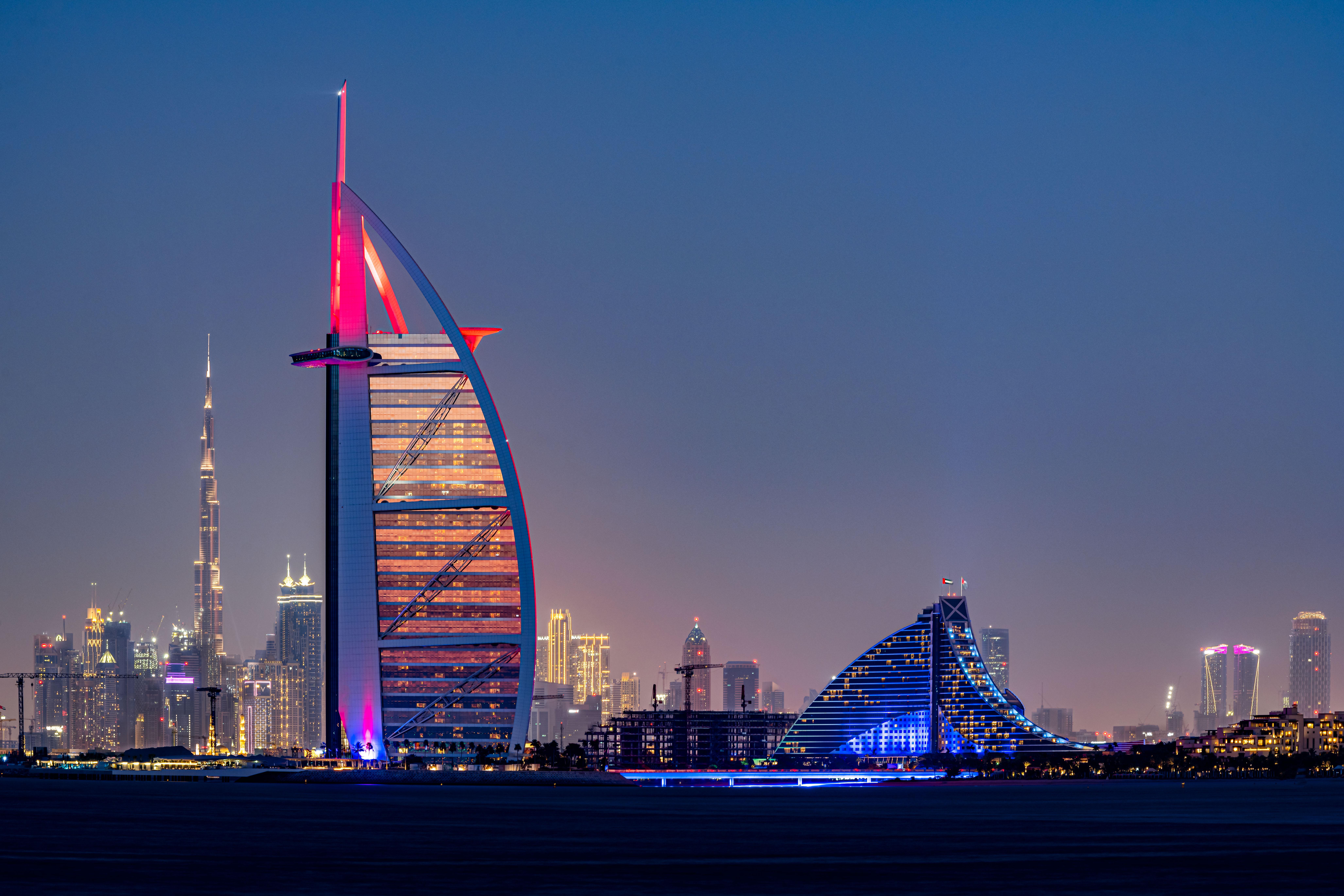 The Burj Al Arab & Jumeirah Beach Hotel, with Burj Khalifa in the background.